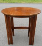 Oval Nest of Three Mahogany Coffee Tables